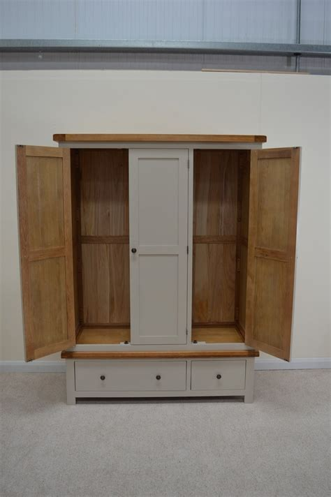 bishop painted three door wardrobe with storage drawers