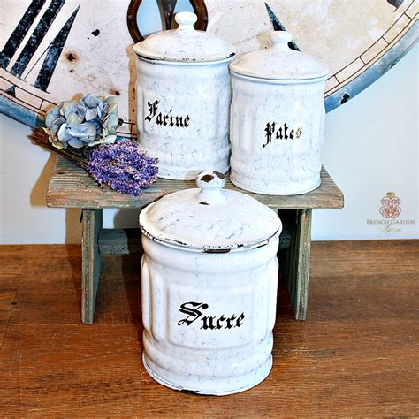 vintage canister set antique white with ornate details antique french enamelware white and blue canister set of 3