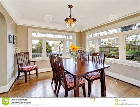 Bright Dining Room by Bright Dining Room With Wooden Table Set Stock Photo