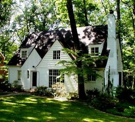 White House Cottages by White Cottage In The Woods Plus A White Picket Fence And Flowers Is The Exterior Of