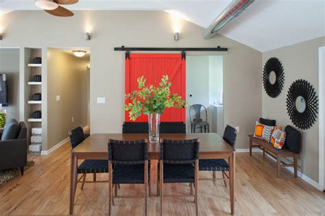 restaurants with rooms cincinnati barn door with view of dining table transitional dining room cincinnati by