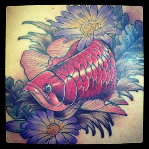 flowers and red arowana tattoo jasmin austin http