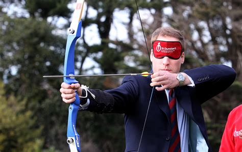 photos of prince william wearing blindfold shooting arrow at st dunstans says we ll to wait