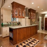 Hanging Kitchen Cabinets On Wall by Attractive Wooden Cabinets Hanging On Brick Kitchen Wall