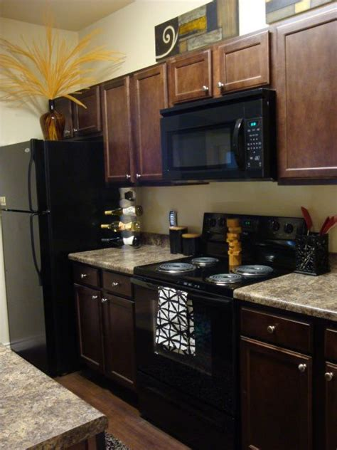 Wood Cabinets With Black Appliances by 25 Best Black Appliances Ideas On