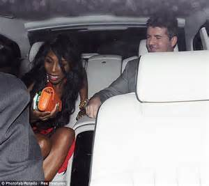 It must have been hot in there a flushed simon cowell shows off his