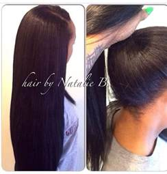 hair do with sew in weave with a part in the middle versatile sew in hair weaves that can be pulled into a