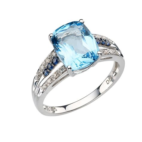 Blue Sapphire 2 9ct 9ct white gold blue topaz and sapphire set ring
