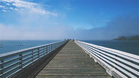 boat walk definition free images sea coast water ocean horizon dock sky