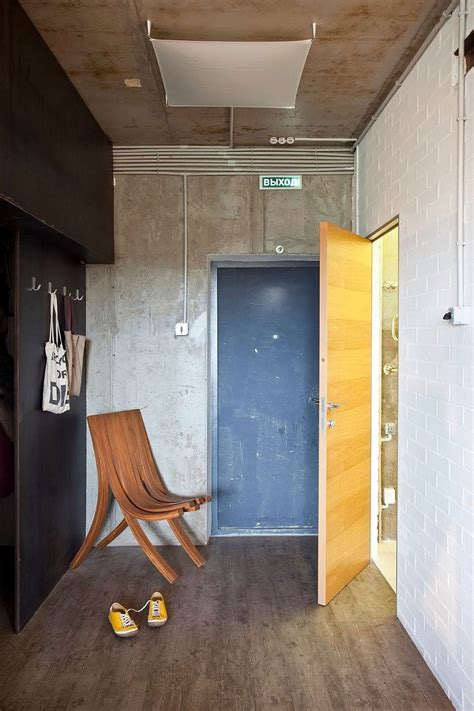 exposed concrete walls in interior design decor small modern industrial apartment draped in metal wood