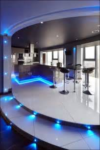 Led lighting in blue color choice decorating flower and under kitchen