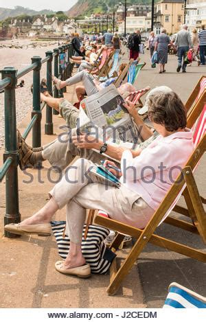 sun l for people old people enjoying the beach scene whilst sitting in the
