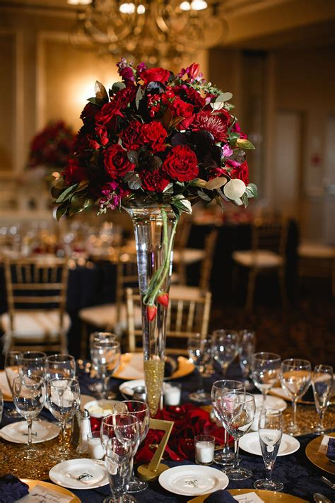 High Vase Centerpieces by Winter Flowers Leigh Florist
