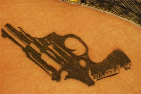 big guns tattoo big black realistic gun hip tattooimages biz