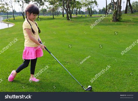 girl golf swing little girl just swing golf ball stock photo 94484593