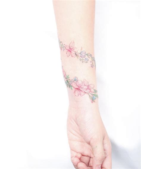 tattoos that wrap around the wrist 50 amazing wrist tattoos for tattooblend