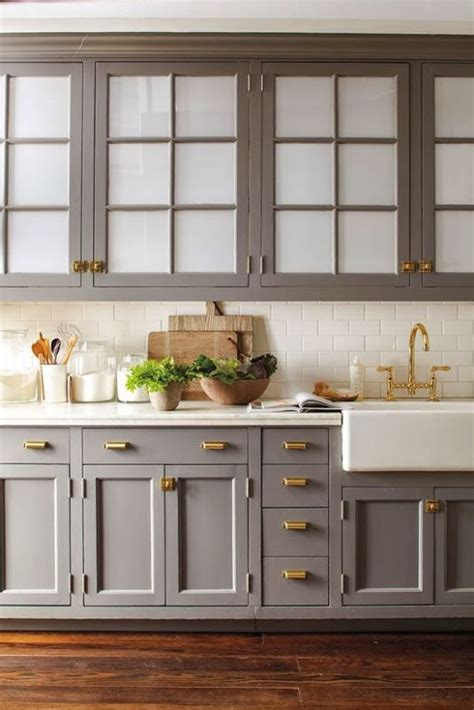 Hardware For White Kitchen Cabinets by Gray Kitchen Cabinets With Brass Hardware And White Marble
