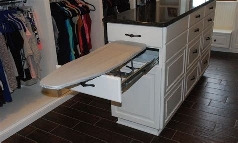 Kitchen Island Storage Table by Ironing Board Cabinet Extensions For Organized Laundry Rooms