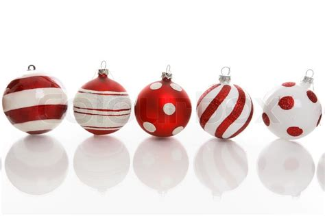 red and white christmas baubles with various designs on a