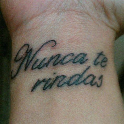 spanish wrist tattoos wrist saying nunca te rindas