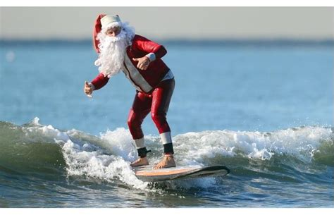 santa on surfboard photos surfing santa