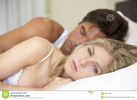free bedroom sex worried young man sitting on armchair with woman in