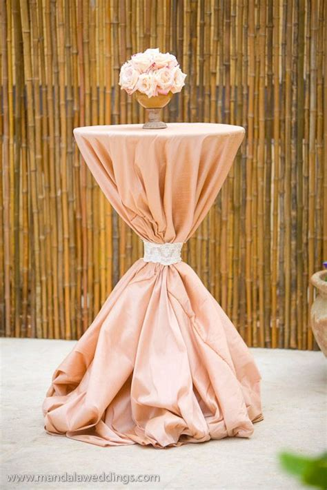 cocktail linen ties oversizes tablecloth and sash to create this gorgeous