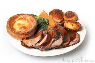 Traditional british sunday roast beef dinner with yorkshire pudding