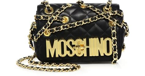 moschino crossover chain quilted leather crossbody bag in