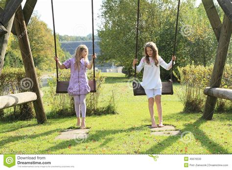 swinging girls kids girls on swing stock image image of cute