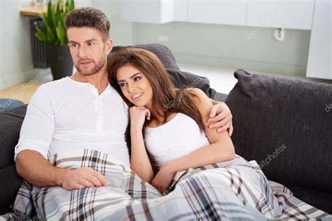 couple on sofa cute couple relaxing on couch stock photo 169 2mmedia