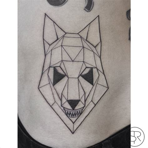 small symbols and geometrical tattoos on arm real photo