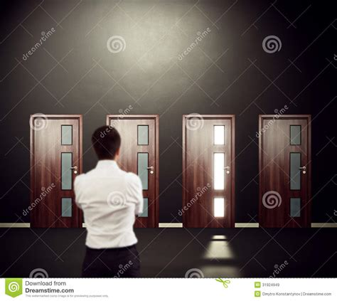 search results for doors and rooms horror solution black thoughtful man in room with doors stock photo