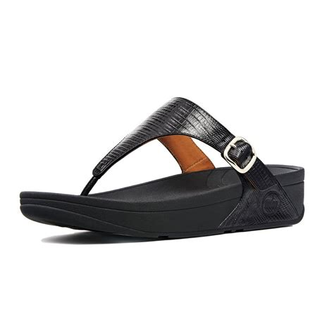 black sandal fitflop style sandal in black embossed