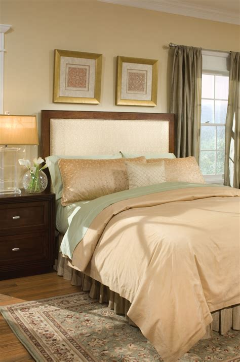 farrah upholstered bed with tufted headboard and turned