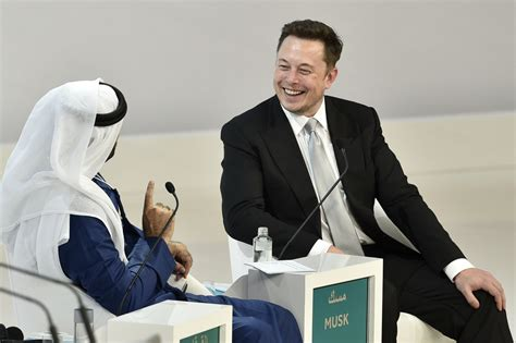 elon musk dubai elon musk says humans need to merge with machines or risk