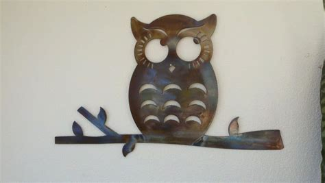thoughtful owl recycled metal wall colored patina