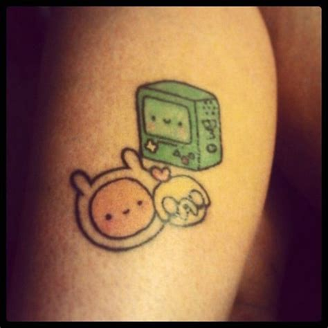 adventure time tattoo finn jake and bmo omg i d get finn and