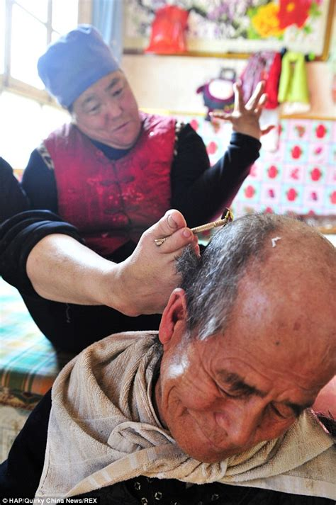 wife shaving husband disabled woman in china shaves her husband s head using