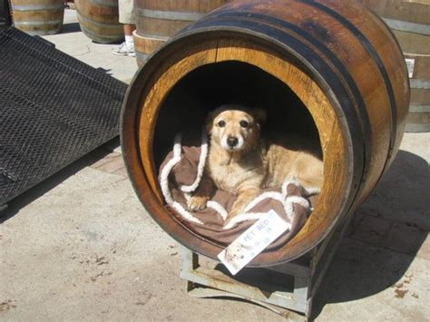 dog house barrel rustic pet house made from a wine or whiskey barrel sits on a rack and we can custom