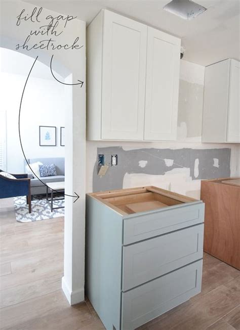 gap between cabinet and wall tip designer is using sheetrock to extend the wall which
