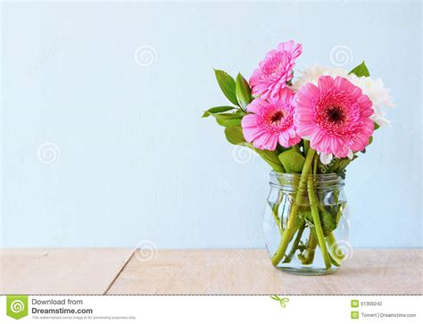 table flower summer bouquet of flowers on the wooden table with mint
