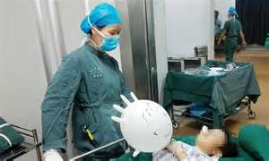 stop comfort nursing chinese woman makes a balloon out of a surgery glove to
