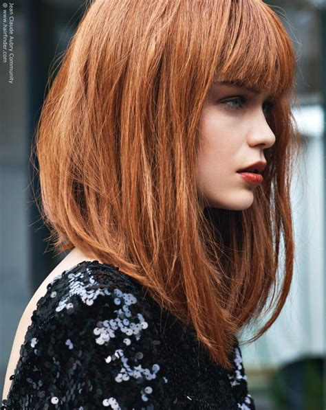 haircuts hair in front longer than hair in back red hair in a long bob with a back to front angle