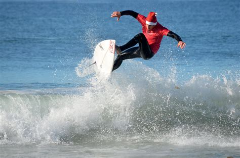 santa on surfboard santa claus is comin to surf annual surfing santa competition comes to salt creek benefits
