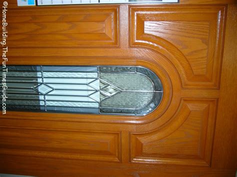 which is a better front entry door choicefiberglass or