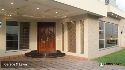 1 kanal colonial design house at phase 6 dha by core a well designed 1 kanal house is available for sale in dha