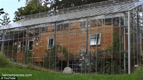 swedish family surround their home with glass to keep in