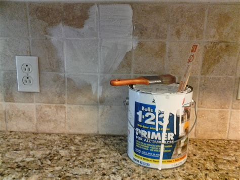how to paint tile backsplash in kitchen and wisor painting a tile backsplash and more easy kitchen updates