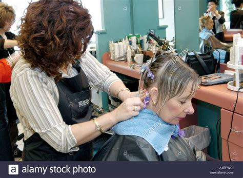 beutician pics of hairstsyles they have done woman has hair cut shoo color and permanent done by a